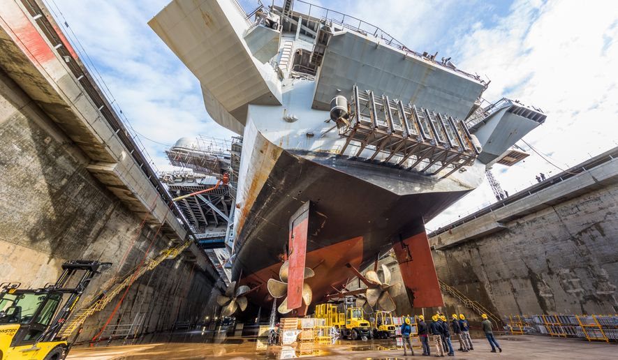 USS Nimitz (CVN 68) in  Dry Dock 6 post dewatering at Puget Sound Naval Shipyard & Intermediate Maintenance Facility in Bremerton, Wash., March 5, 2018. This is the beginning of a nine-month dry dock portion of the Nimitzs Docking Planned Incremental Availability maintenance period. (PSNS & IMF photo by Thiep Van Nguyen II) ** FILE **