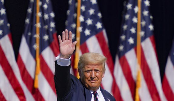 President Donald Trump waves to the audience after speaking at a campaign rally at Mariotti Building Products, Thursday, Aug. 20, 2020, in Old Forge, Pa. (AP Photo/John Minchillo)
