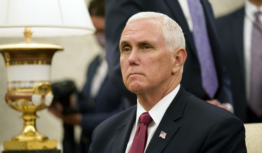 Vice President Mike Pence listens to a reporter's question during a meeting with President Donald Trump and Iraqi Prime Minister Mustafa al-Kadhimi in the Oval Office of the White House, Thursday, Aug. 20, 2020, in Washington. (AP Photo/Patrick Semansky)
