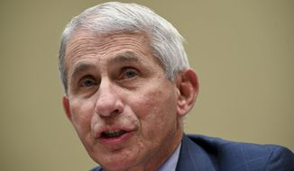 In this July 31, 2020, file photo, Dr. Anthony Fauci, director of the National Institute for Allergy and Infectious Diseases, testifies before a House Select Subcommittee hearing on the Coronavirus, on Capitol Hill in Washington.  (Erin Scott/Pool via AP)