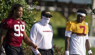 Washington defensive end Chase Young (99), left, head coach Ron Rivera, and quarterback Dwayne Haskins Jr., (7) arrive for practice at the team's NFL football training facility, Thursday, Aug. 20, 2020, in Ashburn, Va. (AP Photo/Alex Brandon)