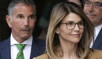 In this April 3, 2019, file photo, actress Lori Loughlin, front, and husband, clothing designer Mossimo Giannulli, left, depart federal court in Boston after facing charges in a nationwide college admissions bribery scandal. The famous couple pleaded guilty to charges in May 2020, and are scheduled to be sentenced on Friday, Aug. 21, 2020. (AP Photo/Steven Senne, File)