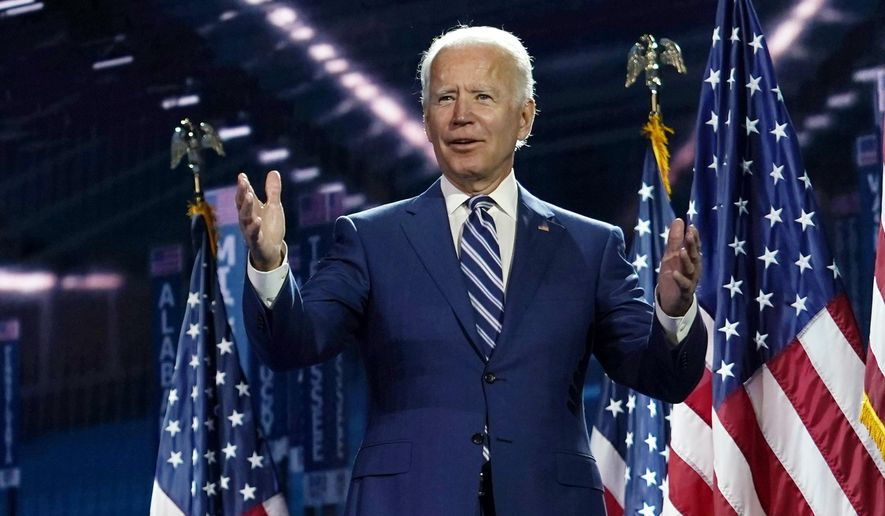 Democratic presidential candidate former Vice President Joe Biden stands on stage after Democratic vice presidential candidate Sen. Kamala Harris, D-Calif., spoke during the third day of the Democratic National Convention, Wednesday, Aug. 19, 2020, at the Chase Center in Wilmington, Del. (AP Photo/Carolyn Kaster)