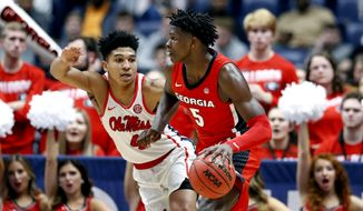 In this March 11, 2020, file photo, Georgia guard Anthony Edwards (5) drives against Mississippi's Breein Tyree (4) in the second half of an NCAA college basketball game in the Southeastern Conference Tournament in Nashville, Tenn. Edwards is expected to be a contender for the No. 1 draft pick in the NBA draft lottery Thursday, Aug. 20, 2020. (AP Photo/Mark Humphrey, File)  **FILE**