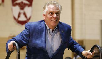 In this March 1, 2020, photo former Virginia Gov. Terry McAuliffe walks up to the stage as he prepares to introduce Democratic presidential candidate former Vice President Joe Biden, during a campaign rally in Norfolk, Va. McAuliffe has filed paperwork to run for his old job next year but says he's still hasn't made an official decision yet. (AP Photo/Steve Helber)