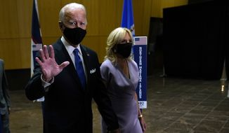 Democratic presidential candidate former Vice President Joe Biden walks to an outdoor stage with his wife Jill Biden during the fourth day of the Democratic National Convention, Thursday, Aug. 20, 2020, at the Chase Center in Wilmington, Del. (AP Photo/Andrew Harnik)