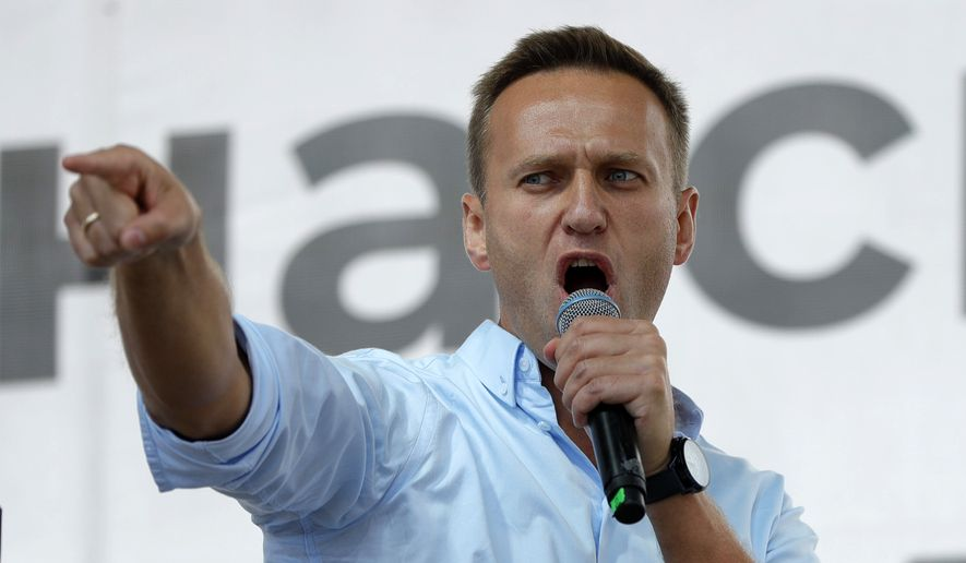 In this file photo taken on Saturday, July 20, 2019, Russian opposition activist Alexei Navalny gestures while speaking to a crowd during a political protest in Moscow, Russia. (AP Photo/Pavel Golovkin, File)
