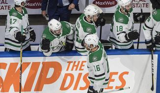 Dallas Stars' Joe Pavelski (16) celebrates a goal against the Calgary Flames during second-period NHL Western Conference Stanley Cup playoff hockey game action in Edmonton, Alberta, Thursday, Aug. 20, 2020. (Jason Franson/The Canadian Press via AP)