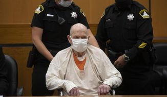 Joseph James DeAngelo, sitting in a wheelchair, is brought out of the courtroom for a break in the schedule for the third day of victim impact statements at the Gordon D. Schaber Sacramento County Courthouse on Thursday, Aug. 20, 2020, in Sacramento, Calif. DeAngelo, 74, a former police officer in California eluded capture for four decades before being identified as the Golden State Killer. DeAngelo pleaded guilty in June to 13 murders and 13 rape-related charges stemming from crimes in the 1970s and 1980s. (Santiago Mejia/San Francisco Chronicle via AP, Pool)