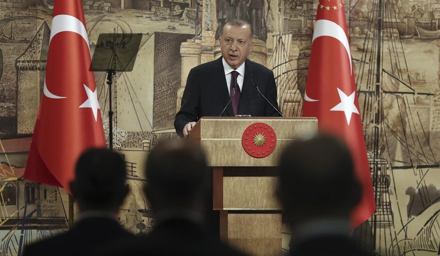 Turkey's President Recep Tayyip Erdogan speaks in Istanbul, Friday, Aug. 21, 2020. Mr. Erdogan has ordered the Chora Church in Istanbul, currently a museum and renowned for its Byzantine architecture, luscious frescoes and Biblical mosaics, to be converted into a mosque, according to multiple reports. (Turkish Presidency via AP, Pool)