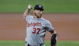 Washington Nationals starting pitcher Stephen Strasburg throws a pitch to the Baltimore Orioles during the first inning of a baseball game, Friday, Aug. 14, 2020, in Baltimore. (AP Photo/Julio Cortez)  **FILE**