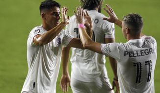Inter Miami forward Julian Carranza, left, is congratulated by Matias Pellegrini (11) after scoring a second goal against Orlando City during the first half of an MLS soccer match Saturday, Aug. 22, 2020, in Fort Lauderdale, Fla. (AP Photo/Jim Rassol)