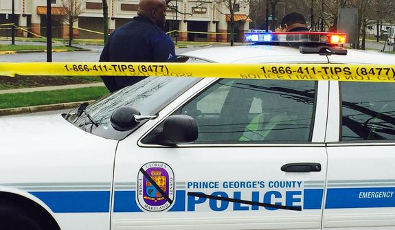 Prince George's County police block the road to the police station, Monday morning.  (AP File Photo/Jessica Gresko)