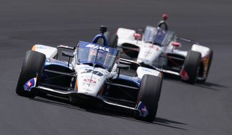 Takuma Sato, of Japan, leads Marco Andretti into turn one during the Indianapolis 500 auto race at Indianapolis Motor Speedway, Sunday, Aug. 23, 2020, in Indianapolis. (AP Photo/Darron Cummings)