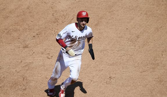 Washington Nationals' Trea Turner runs towards third en route to scoring on a double by Adam Eaton the during the fourth inning of a baseball game against the Miami Marlins, Sunday, Aug. 23, 2020, in Washington. (AP Photo/Nick Wass)