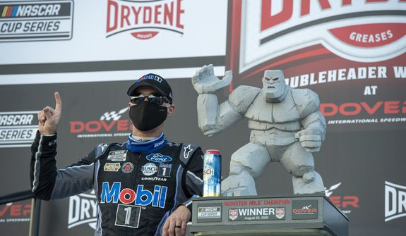 Kevin Harvick celebrates after winning a NASCAR Cup Series auto race at Dover International Speedway, Sunday, Aug. 23, 2020, in Dover, Del. (AP Photo/Jason Minto)