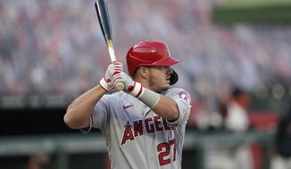 Los Angeles Angels' Mike Trout bats against the San Francisco Giants during the first inning of a baseball game in San Francisco, Wednesday, Aug. 19, 2020. (AP Photo/Jeff Chiu)
