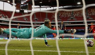 PSG's goalkeeper Keylor Navas reaches for the ball during the Champions League final soccer match between Paris Saint-Germain and Bayern Munich at the Luz stadium in Lisbon, Portugal, Sunday, Aug. 23, 2020.(Matthew Childs/Pool via AP)
