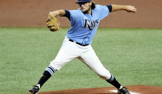 Tampa Bay Rays starter Josh Fleming makes his major league debut during the first inning of a baseball game against the Toronto Blue Jays, Sunday, Aug. 23, 2020, in St. Petersburg, Fla. (AP Photo/Steve Nesius)