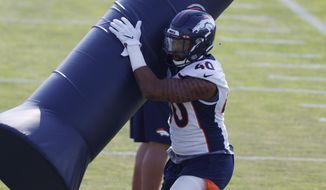 Denver Broncos linebacker Justin Strnad takes part in drills during an NFL football practice at the team's headquarters Wednesday, Aug. 19, 2020, in Englewood, Colo. (AP Photo/David Zalubowski)