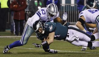 FILE - In this Dec. 22, 2019, file photo, Dallas Cowboys' Malcolm Smith (43) tackles Philadelphia Eagles' Carson Wentz during the second half of an NFL football game in Philadelphia. Thin and inexperienced at linebacker, the Cleveland Browns signed former Super Bowl MVP Smith on Sunday, Aug. 23, 2020. (AP Photo/Chris Szagola, File)