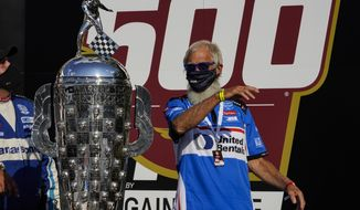 Car owner David Letterman celebrates after his driver, Takuma Sato, of Japan, won the Indianapolis 500 auto race at Indianapolis Motor Speedway in Indianapolis, Sunday, Aug. 23, 2020. (AP Photo/Michael Conroy)