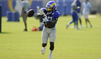 Los Angeles Rams running back Darrell Henderson Jr. gets the ball pitched to him during an NFL football camp practice Wednesday, Aug. 19, 2020, in Thousand Oaks, Calif. (AP Photo/Marcio Jose Sanchez)