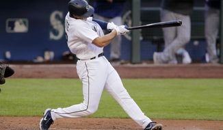 Seattle Mariners' Evan White hits a three-run home run off Texas Rangers' Jordan Lyles during the third inning of a baseball game Saturday, Aug. 22, 2020, in Seattle. (AP Photo/John Froschauer)