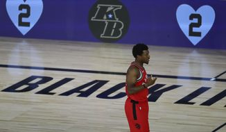 Toronto Raptors guard Kyle Lowry (7) against the Brooklyn Nets during the first half of Game 4 of an NBA basketball first-round playoff series, Sunday, Aug. 23, 2020, in Lake Buena Vista, Fla. (Kim Klement/Pool Photo via AP)