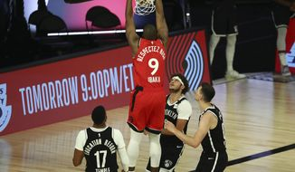 Toronto Raptors center Serge Ibaka (9) dunks to score a basket against the Brooklyn Nets during the second half of Game 4 of an NBA basketball first-round playoff series, Sunday, Aug. 23, 2020, in Lake Buena Vista, Fla. (Kim Klement/Pool Photo via AP)
