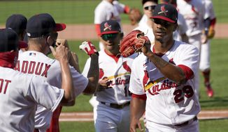 St. Louis Cardinals relief pitcher Alex Reyes (29) celebrates with his teammates following a 6-2 victory over the Cincinnati Reds a baseball game Sunday, Aug. 23, 2020, in St. Louis. (AP Photo/Jeff Roberson)