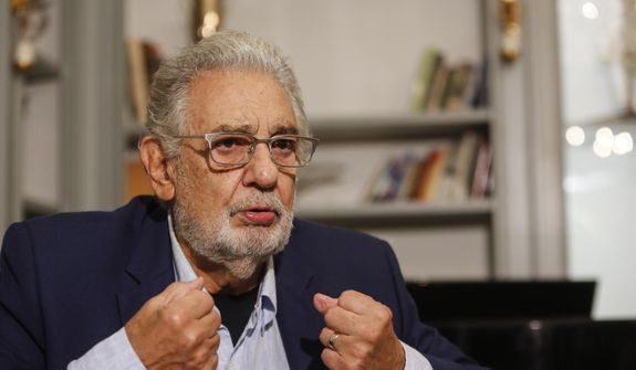 """Spanish tenor Placido Domingo gestures during an interview with the Associated Press in Naples, Sunday, Aug. 23, 2020. Opera legend Placido Domingo denied ever abusing his power during his management tenure at two U.S. opera houses, as he embarks on a full-throttle campaign to clear his name after two investigations found credible accusations he had engaged with """"inappropriate conduct"""" with multiple women over a period of decades. (AP Photo/Riccardo De Luca)"""