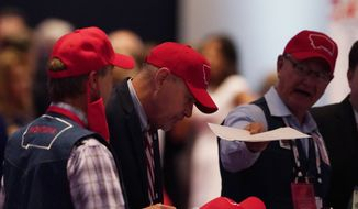 Delegates from Montana arrive for the first day of the Republican National Convention, Monday, Aug. 24, 2020, in Charlotte, N.C. (AP Photo/Chris Carlson, pool)