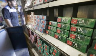 FILE - This May 17, 2018 file photo shows packs of menthol cigarettes and other tobacco products at a store in San Francisco. On Monday, Aug. 24, 2020, the California Assembly voted 50-0 to ban the sale of most flavored tobacco products. The bill heads back to the state Senate, where it is expected to pass and make its way to Gov. Gavin Newsom's desk. The ban does not apply to hookah water pipes and flavored shisha tobacco products. (AP Photo/Jeff Chiu,File)