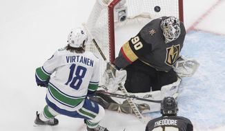 Vegas Golden Knights goalie Robin Lehner (90) makes the save on Vancouver Canucks' Jake Virtanen (18) during the first period in Game 1 of an NHL hockey playoff second-round series Sunday, Aug. 23, 2020, in Edmonton, Alberta.. (Jason Franson/The Canadian Press via AP)