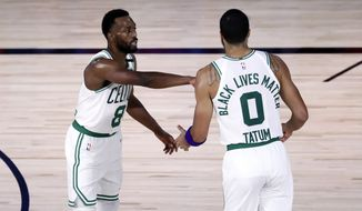 Boston Celtics guard Kemba Walker (8) and forward Jayson Tatum (0) react during the third quarter against the Philadelphia 76ers in Game 4 of an NBA basketball first-round playoff series, Sunday, Aug. 23, 2020, in Lake Buena Vista, Fla. (Kim Klement/Pool Photo via AP)