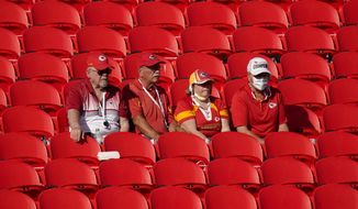 Fans watch the Kansas City Chiefs during an NFL football training camp Saturday, Aug. 22, 2020, at Arrowhead Stadium in Kansas City, Mo. The Chiefs opened the stadium to 2,000 season ticket holders to watch practice as the team plans to open the regular season with a reduced capacity of approximately 22 percent or normal. (AP Photo/Charlie Riedel)