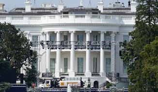 Lights and staging stand on the South Lawn of the White House, Friday, Aug. 21, 2020, in Washington. President Donald Trump is expected to speak to the Republican National Committee convention next week from the South Lawn of the White House. (AP Photo/Patrick Semansky)