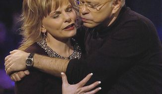 FILE - In this Friday, Dec. 30, 2005 file photo, televangelist Jim Bakker, founder of the former Heritage USA resort, holds his wife, Lori Graham Bakker, as they pray following his sermon, during the MorningStar Fellowship Church New Year's Conference, in Fort Mill, S.C. Bakker gained notoriety in the late 1980s and 1990s as a result of his trial and financial fraud conviction relating to Heritage USA. He moved to southwest Missouri in 2003. (Jeff Siner/The Charlotte Observer via AP)