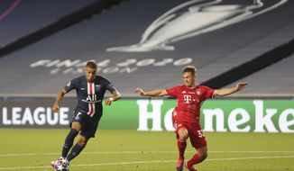 Bayern's Joshua Kimmich, right, challenges PSG's Kylian Mbappe during the Champions League final soccer match between Paris Saint-Germain and Bayern Munich at the Luz stadium in Lisbon, Portugal, Sunday, Aug. 23, 2020. (Miguel A. Lopes/Pool via AP)