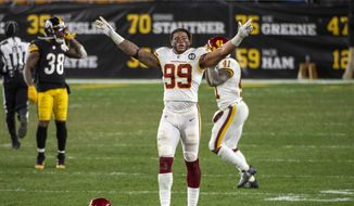 华盛顿足球队 defensive end Chase Young #99 reacts following a 23-17 win over the Pittsburgh Steelers during an NFL football game, Monday, Dec. 7, 2020, in Pittsburgh. (AP Photo/Justin Berl)  **FILE**