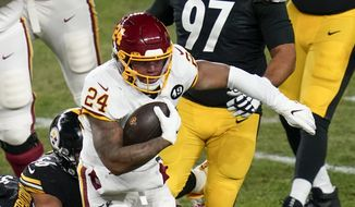 华盛顿足球队 running back Antonio Gibson (24) runs the ball past Pittsburgh Steelers linebacker Alex Highsmith (56) during an NFL football game, Monday, Dec. 7, 2020, in Pittsburgh. (AP Photo/Keith Srakocic) **FILE**