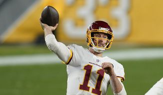 华盛顿足球队 quarterback Alex Smith (11) plays in an NFL football game against the Pittsburgh Steelers, Monday, Dec. 7, 2020, in Pittsburgh. (AP Photo/Keith Srakocic) **FILE**