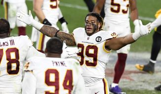 华盛顿足球队 defensive end Chase Young (99) celebrates after a win over the Pittsburgh Steelers in an NFL football game in Pittsburgh, Monday, Dec. 7, 2020. (AP Photo/Barry Reeger) **FILE**