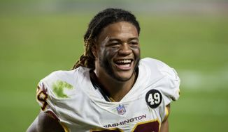 华盛顿足球队 defensive end Chase Young (99) laughs after an NFL football game against the San Francisco 49ers, Sunday, Dec. 13, 2020, in Glendale, Ariz. (AP Photo/Jennifer Stewart)  **FILE**