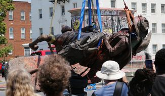 The statue of Confederate General J.E.B. Stuart is removed from its pedestal on Monument Avenue in Richmond, Virginia, last July. A Canadian sculptor disagrees with the push to remove Confederate statues across the U.S. He calls the effort arrogant. (Associated Press Photograph)
