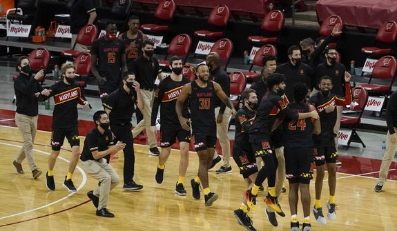 The 马里兰州 bench react after an NCAA college basketball game Wisconsin Monday, Dec. 28, 2020, in Madison, Wis. 马里兰州 won 70-64. (AP Photo/Morry Gash) **FILE**