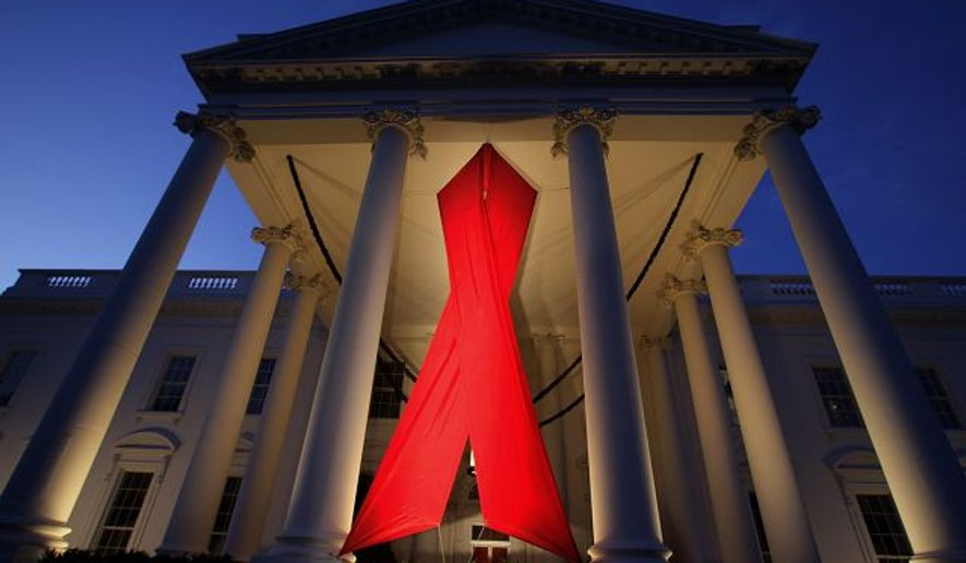 ** FILE ** The North Portico of the White House was decorated with a giant AIDS ribbon to commemorate World AIDS Day, Dec. 1, 2007, which is designed to raise global awareness about the pandemic.