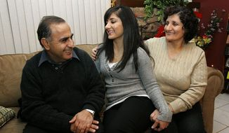 ** FILE ** In this 2008 file photo, Assyrian Christians Isaac Samow and his wife, Ziada, say their children, including Hala (center) still speak their language, but they fear the loss of their culture in their grandchildren in asylum in Modesto, Calif., and among other Assyrians fleeing the violence and persecution in the ancient homeland of Mesopotamia. (Associated Press)