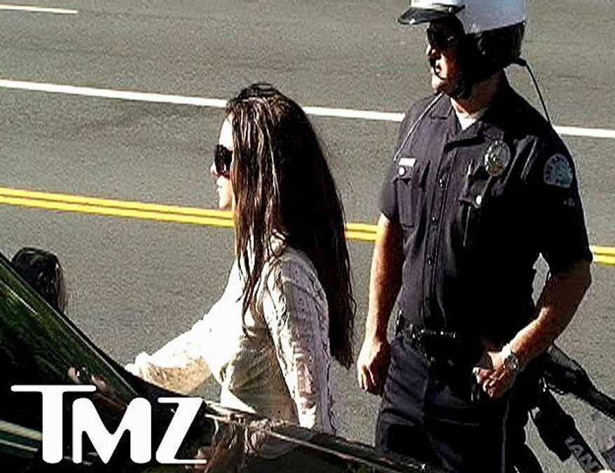 In this image taken from video and released by TMZ, Britney Spears arrives to court in Los Angeles Monday, Jan. 14, 2008 for her child custody ruling. Superior Court commissioner decided Monday to keep in effect an earlier order suspending Britney Spears' right to visit her two sons and keeping them in ex-husband Kevin Federline's custody. (Associated Press)